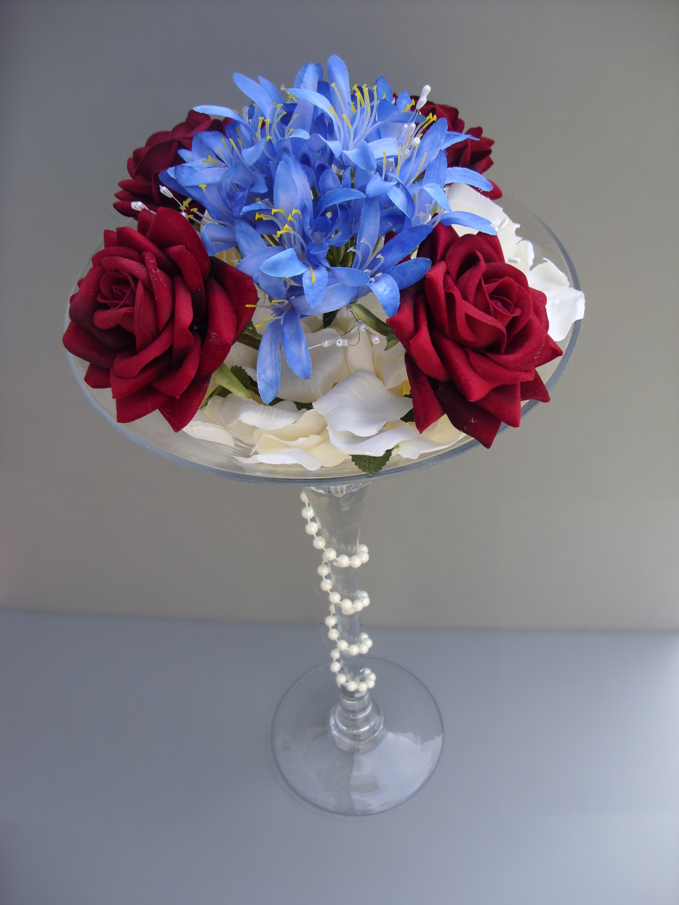 Bridal flowers simply flowers by julie martini vase red roses blue agapanthus 4400 floridaeventfo Images