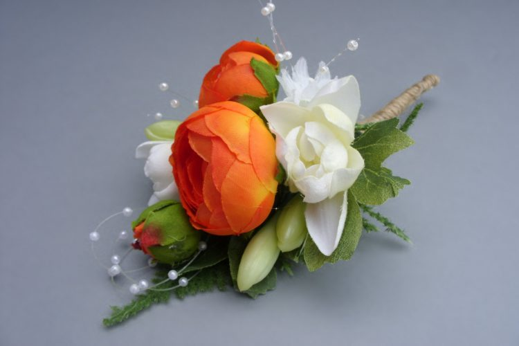 Corsage - Tuberose, Orange Ranunculus, Pearl Loop and Baby's Breath - from £9.00