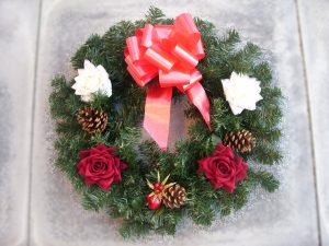 "18"" Wreath - Red & White Roses, Cones, Poinsettia & Cone Pick & Red Bow - from £15.00"