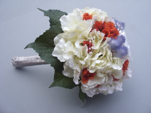 Hydrangea, Mist flower with Burnt Orange Bud Roses and Diamante. Stems wrapped in cream satin ribbon - from £85.00